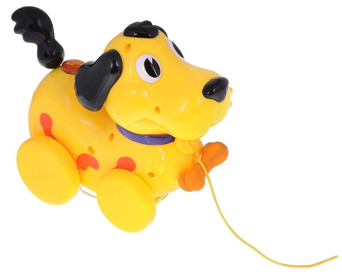Музыкальная Собачка 11 мелодий, светМузыкальная игрушка-каталка Navystar Собачка привлечет внимание вашего малыша и не оставит его равнодушным. Игрушка снабжена четырьмя колесиками со свободным ходом. Игрушка выполнена из прочного пластика в виде забавного желтого песика с хвостиком на пружинке. На теле собачки расположена кнопка, при нажатии на которую, воспроизводятся разные мелодии в виде музыкального лая, и мигает яркий огонек. Игрушка воспроизводит 11 различных мелодий. Игрушка дополнена текстильным шнурком, с помощью которого ее можно катать по полу. Музыкальная игрушка-каталка Navystar Собачка поможет малышу развить цветовое и звуковое восприятие, координацию движений и мышление.<br>