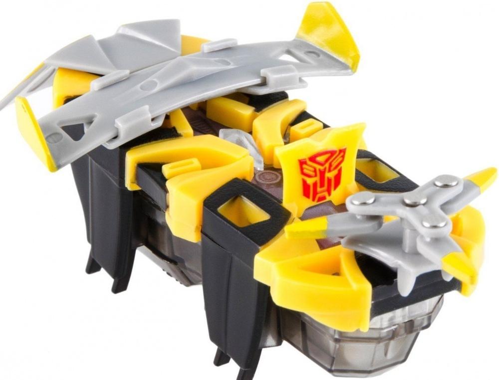 Микро-робот Hexbug Трансформер в ассортиментеМикро-роботы серии Warriors Transformers позволяют собрать коллекцию из таких роботов как: Бамблби, Метеор, Дрифт, Гальватрон, Локдаун, Оптимус Прайм и другие. Микро-роботы Warriors Transformers поставляются со сменными элементами амуниции. За счет встроенного микродвигателя и 12 ножек, его поведение повторяет поведение настоящего жука. При соприкосновении с препятствием энергичное насекомое меняет свое направление движения, и бежит прочь благодаря своему непредсказуемому поведению. Каждый микро-робот Transformers оснащен замаскированным всплывающим элементом, который показывает, чью сторону он избрал. А индикатор уровня жизни олицетворяет собой Искру. Роботы имеют два режима работы, тестовый, чтобы наблюдать за его хаотичным передвижением и основной — боевой. После получения ударов от соперника, Warriors Transformers начинает моргать цветовым индикатором. Зеленый — робот еще способен на многое, желтый — здоровье на середине, красный — будь аккуратнее. После получения критического урона, робот деактивируется, покорно принимая свое поражение.<br>