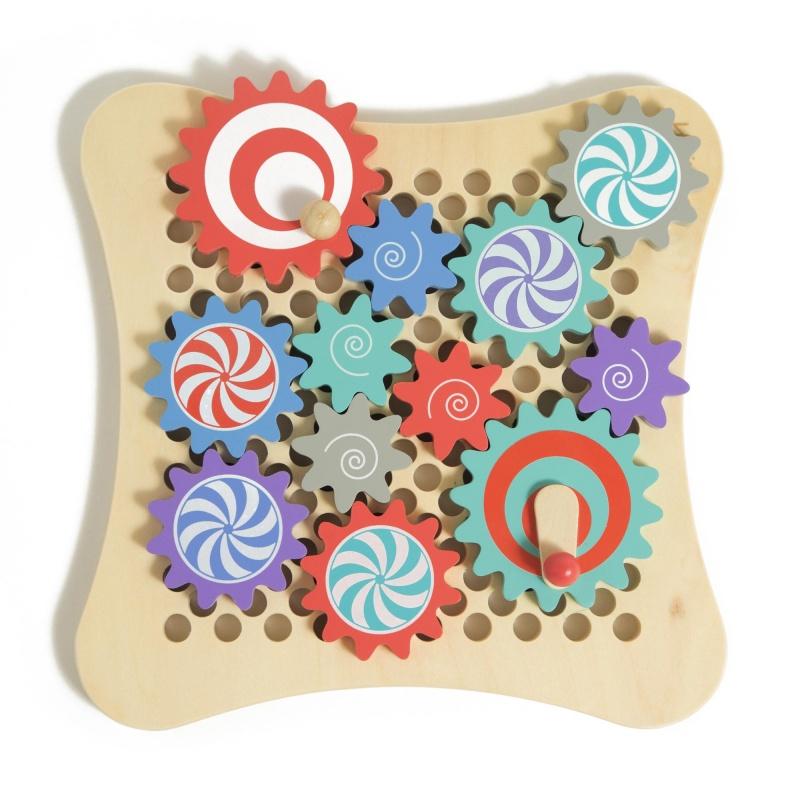 Игрушка деревянная Веселые шестеренкиИгрушка деревянная Веселые шестеренки выполнена из натурального, экологически чистого материала, который не вызывает аллергии и не содержит токсичных веществ. Такая игра благотворно влияет на развитие малыша, помогая усвоить азы логики, натренировать память и освоить творческое мышление. Товар, приобретенный в магазине Hamleys, порадует вас невысокой ценой и отличным качеством. На эту игрушку поступило большое число положительных отзывов от покупателей. Жители Москвы, Санкт-Петербурга и Краснодара могут посетить магазин Hamleys и купить игрушку самостоятельно, или заказать доставку с курьером по любому адресу, оплатив ее банковской карточной или наличными. Для жителей других регионов страны действует оплата наложенным платежом.<br>