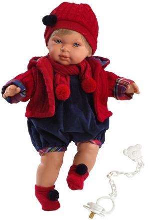 Кукла Llorens Мигуэль, 42 см.Кукла Мигуэль от испанской компании Llorens выглядит очень реалистично, её приятная внешность напоминает маленькую девочку. У неё милые младенческие черты лица: пухлые щёчки, губки и выразительные глазки. Кукла одета в стильный наряд – тёмно-синий комбинезон, а сверху для тепла у куклы имеется вязаный ансамбль, который состоит из вязаной куртки, шапки, шарфика и носочков с помпонами красного цвета. Малышка не расстаётся со своей соской, а когда теряет её - начинает плакать и звать родителей.<br>