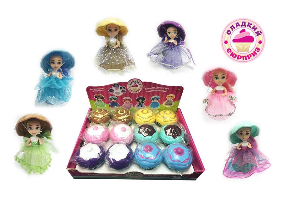 Сладкий сюрприз. Набор кукол, 6 видов, 12 шт. в дисплее (цена за 1 шт)Милая кукла с шапочкой очень похожа на пирожное. Игрушка имеет подвижные руки и одета в красивое платье с пышной юбкой, цвет которой соответствует определенному пирожному. Куклу можно трансформировать в капкейк, который можно будет использовать в воображаемых чаепитиях или на игрушечной кухне. С куклой-пирожное ребенок сможет придумать разнообразные сюжеты для игр.<br>