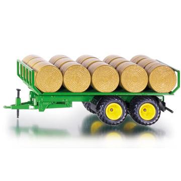 Моделька Прицеп для перевозки круглых кип (1:32) SikuИгрушечная модель прицеп для перевозки круглых тюков, корпус прицепа выполнен из металла, колёса выполнены из резины и вращаются. Прицеп можно использовать с тракторами SIKU масштаб 1:32 оборудованными сцепным устройством. В комплекте рулоны сена из пластмассы.<br>
