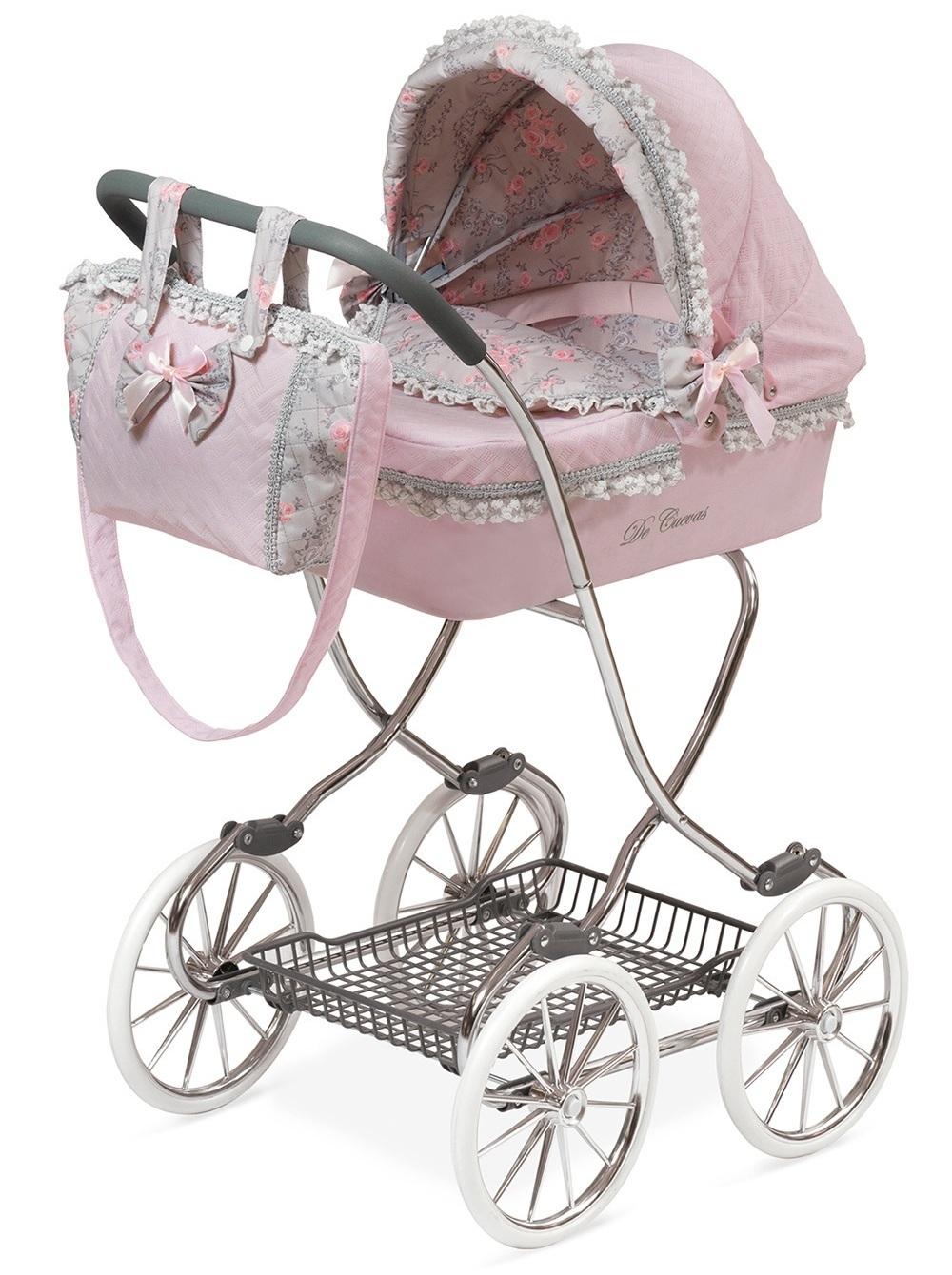 Коляска с сумкой и зонтиком серии Романтик, розовая, 90 см.Дизайнерские коляски для кукол Munecas Antonio Juan. Изысканная отделка, нарядные детали (банты, рюши, кружева, помпоны), прорезиненные колеса, металлический каркас.<br>