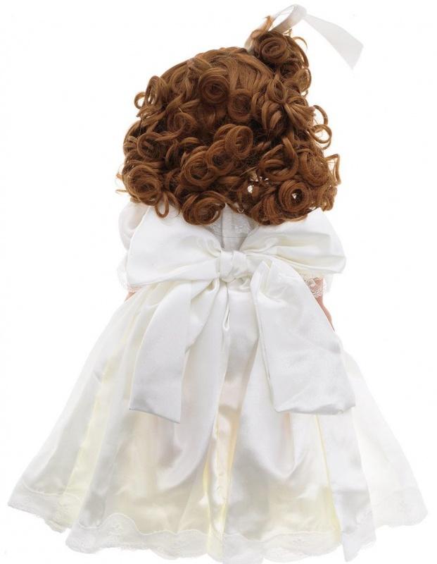 Кукла Precious Moments Изящная невеста, брюнетка, 40 см.Кукла Precious Moments Изящная невеста 1199 станет отличным подарком для любой девочки на день рождения или другой праздник. Она изготовлена из текстиля, винила и не оставит равнодушными ценителей прекрасного. Кукла одета в нарядный костюм, не перегруженная деталями и декором, а также выполнена с теми нюансами, которые очень высоко ценится коллекционерами.<br>