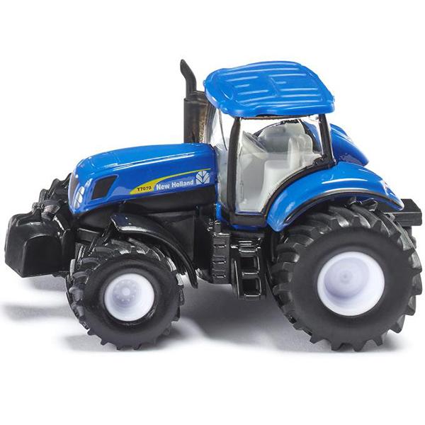 Трактор син. (1:87)Игрушечная модель трактор New Holland 7070 (Нью-Холланд). Корпус трактора выполнен из металла, кабина из пластмассы, стёкла из прозрачной пластмассы, колёса выполнены из резины и вращаются, можно катать. Трактор оборудован сцепным устройством совместимым с прицепами и навесным оборудованием SIKU FARMER масштаба 1:87.Размер игрушки:6.4 х 3.4 х 3.7 см<br>