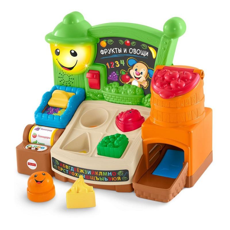 Fisher-Price Прилавок с фруктами и овощамиОбучающий прилавок Веселые фрукты из серии Смейся и учись от производителя Fisher-Price - это развивающая игрушка для малышей, которая позволит в игровой форме улучшить память, моторику, логику ребенка, умение правильно говорить и слушать. Яркие и насыщенные краски игрушки способствуют тренировке зрения. В наборе большое количество звуков, фраз и веселых песенок, которые помогут ребенку выучить первые слова, запомнить название фруктов, различать цвета. Можно сортировать фрукты, крутить ролик с их названием, включать и выключать подсветку и совершать другие увлекательные манипуляции с игрушкой. Все это функциональное многообразие делает игровой процесс еще более интересным и захватывающим для малыша.<br>