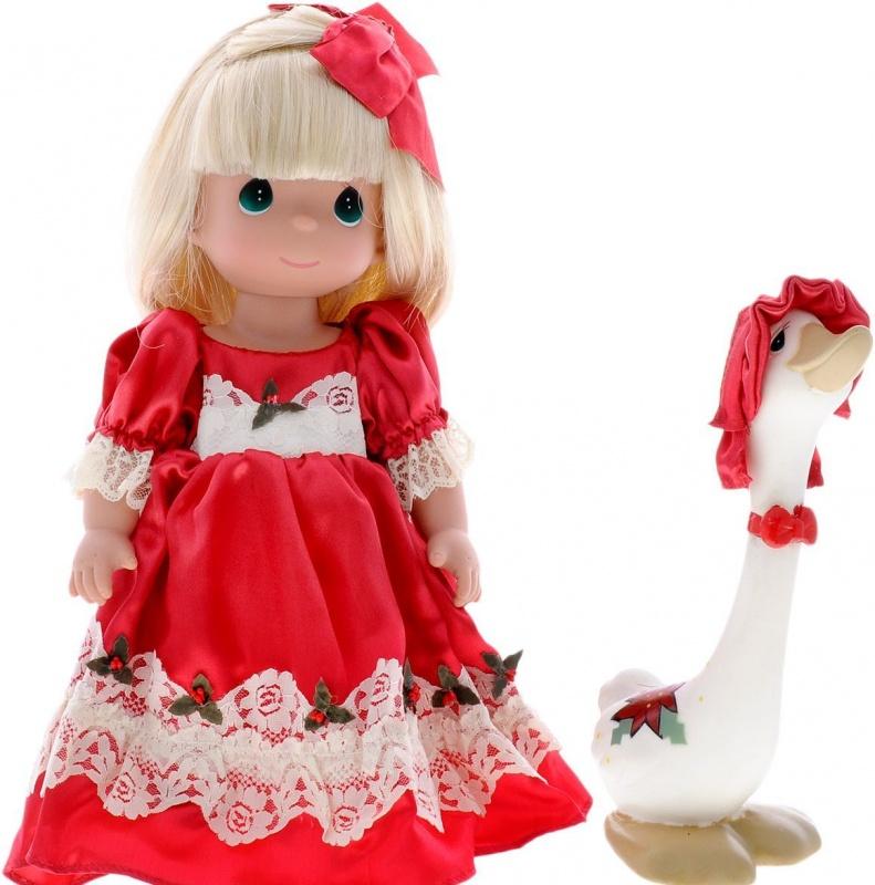 Куклы Precious Moments Рождество, блондинка, 30 см.Коллекция кукол Precious Moments ростом выше 30 см насчитывает на сегодняшний день более 600 видов. Куклы изготавливаются из качественного, безопасного материала и имеют пять базовых точек артикуляции. Каждый год в коллекцию добавляются все новые и новые модели. Каждая кукла имеет свой неповторимый образ и характер. Она может быть подарком на память о каком-либо событии в жизни. Куклы выполнены с любовью и нежностью, которую дарит нам известная волшебница - создатель кукол Линда Рик! Кукла Рождество одета в пышное красное платье и красные туфли. Светлые волосы куклы украшены красным бантом. Вся одежда у куклы съемная. У девочки большие зеленые глаза и длинные светлые волосы. В комплект с куклой входит забавный гусь. Игра с куклой разовьет в вашей малышке чувство ответственности и заботы. Порадуйте свою принцессу таким великолепным подарком!<br>