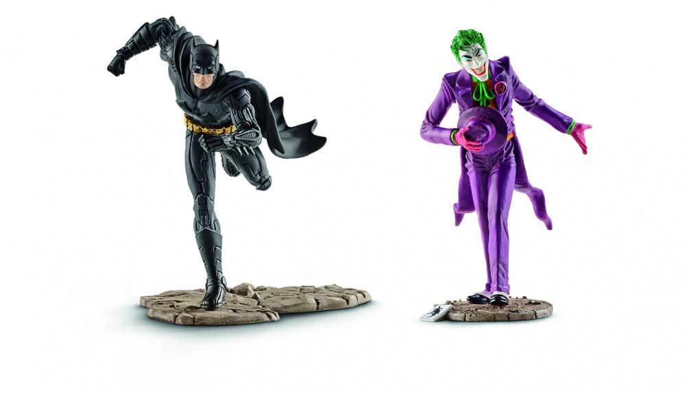 Бэтмен и ДжокерФигурки Бэтмена и его злейшего врага Джокера станут прекрасным подарком для любого мальчика. Ими можно не только играть. Они великолепно впишутся в интерьер комнаты, в которой присутствуют элементы декора знаменитой саги: постеры, часы, модульные картины. Игрушки сделаны качественно. Все детали проработаны с особой тщательностью и скрупулезностью. Благодаря этому смотрятся они очень красиво и сравнимы с сувенирами. Фигурки Бэтмена и Джокера закреплены на подставках, имитирующих камень. Бэтмен выполнен в черной цветовой гамме и смотрится грозно. На его фоне Джокер выглядит ярким и контрастным.<br>