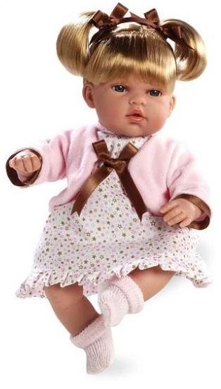 Кукла-блондинка Arias, 33 см.Кукла Elegance, представленная брендом Arias, проработана до мельчайших деталей, поэтому внешне, за исключением размера, игрушка напоминает настоящего годовалого ребенка. Очаровательная куколка одета в платьице и вязаный жакет. Светлые волосы украшают атласные ленточки, а на ножках можно увидеть красивые носочки.Если надавить на живот милой куклы, то можно услышать ее забавный смех. Игрушка прекрасно подойдет как для девичьих игр, так и для коллекционирования, ведь она выполнена весьма реалистично.<br>