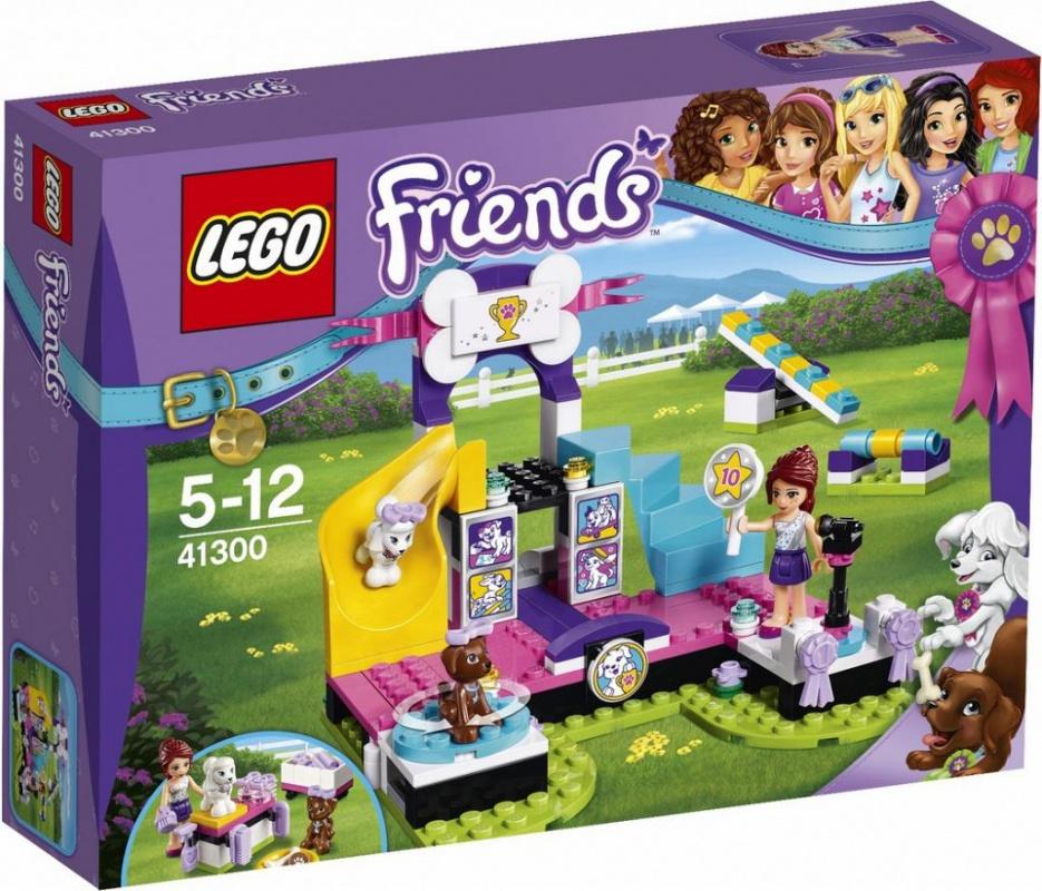 Конструктор Lego Friends Выставка щенков: ЧемпионатВыйди на сцену и произведи фурор, демонстрируя, что умеют твои щенки. Причёсывай их, пока щенки не будут выглядеть самым лучшим образом, и вперёд! Посади Скаута на вращающийся стул, чтобы все увидели его блестящую шёрстку, и осторожно проведи Тину вверх-вниз по качелям, а потом помоги ей преодолеть препятствие. Поднимись по лесенке и выбери победителя вместе с Мией. Чтобы объявить победителя в микрофон, снова спустись в зал. Эти щенки за своё выступление заслужили по сахарной косточке.Информация о набореАртикул: 41300Производитель: LEGOКол-во деталей: 185Фигурок: 1Год выпуска: 2017<br>